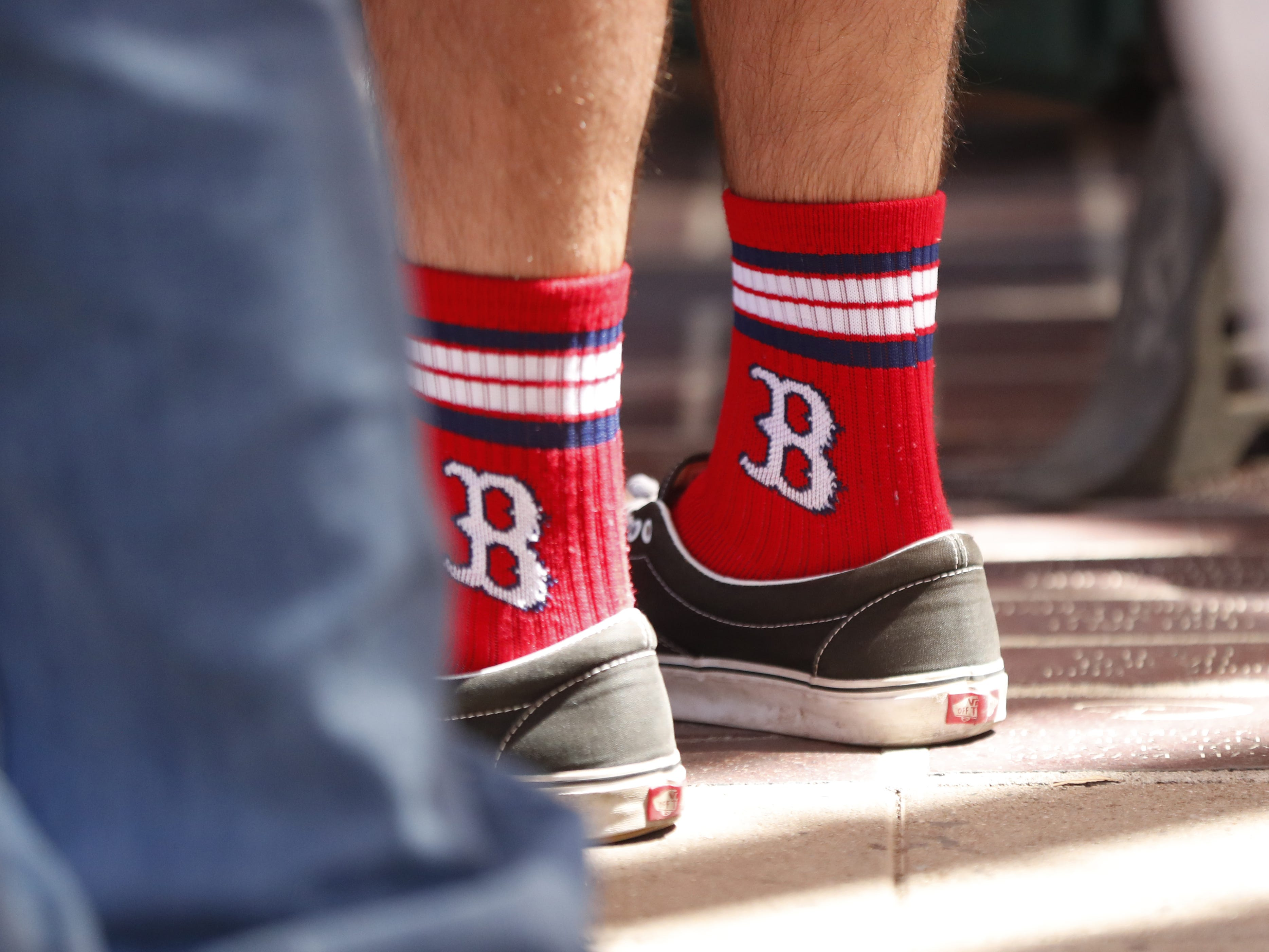 "A Boston Red Sox fan wear his pride on his ""sox"" outside Chase Field on the Opening Day for the Diamondbacks in Phoenix, Ariz. on April 5, 2019."