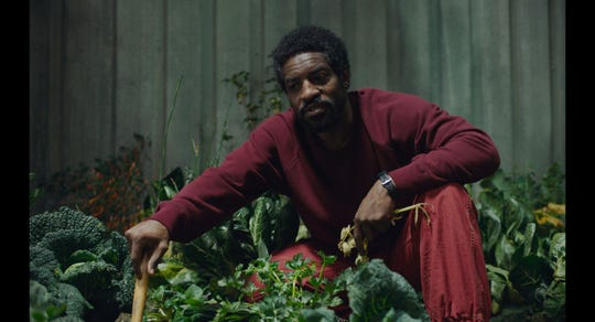 "André Benjamin plays garden caretaker Tcherny in ""High Life."""