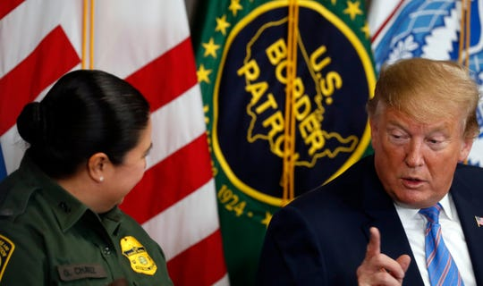 President Donald Trump listens as Gloria Chavez with U.S. Customs and Border Protection speaks at a roundtable on immigration and border security at the U.S. Border Patrol Calexico Station in Calexico, California, April 5, 2019.
