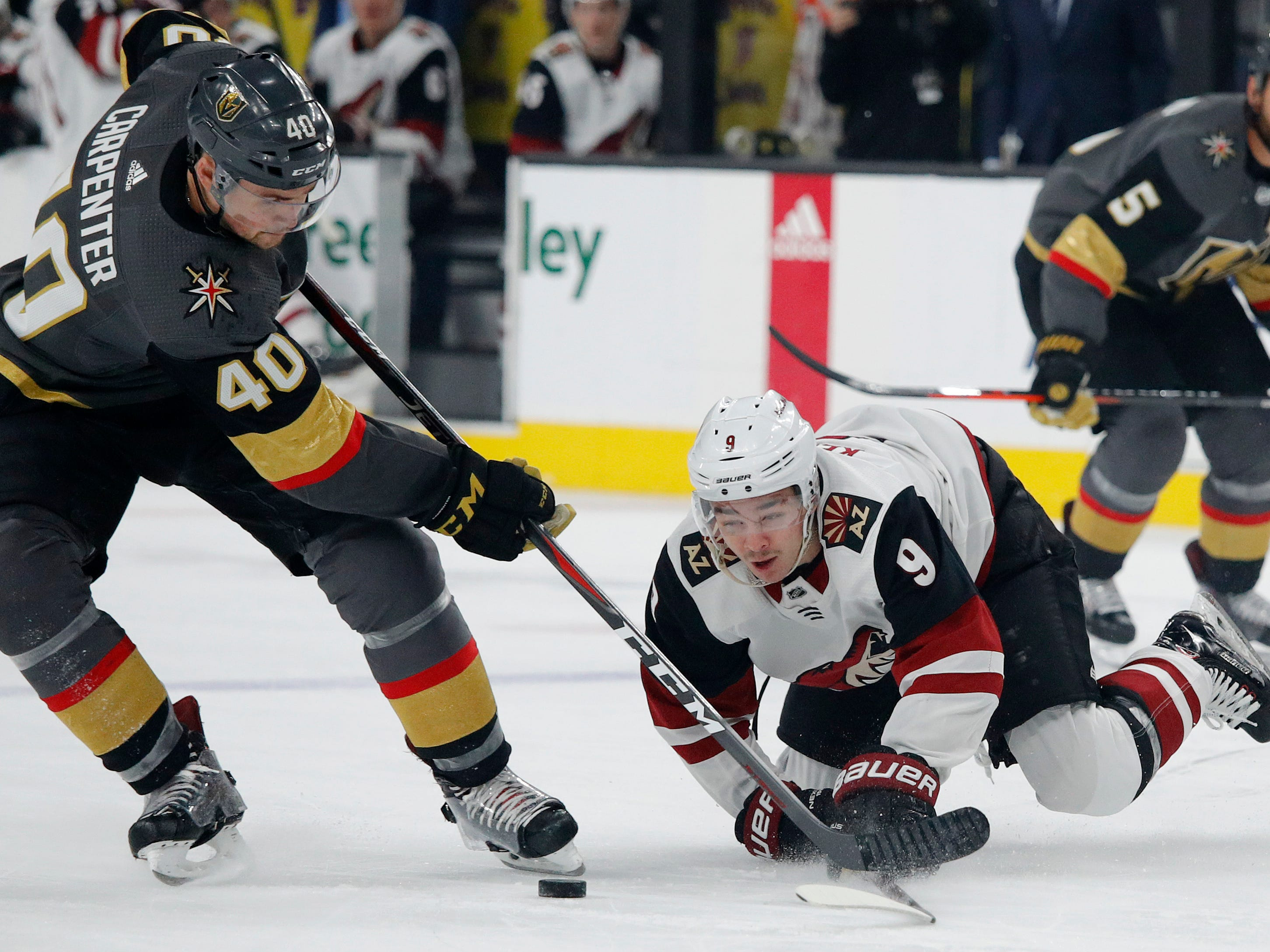 Vegas Golden Knights center Ryan Carpenter (40) and Arizona Coyotes center Clayton Keller (9) vie for the puck during the first period of an NHL hockey game Thursday, April 4, 2019, in Las Vegas.