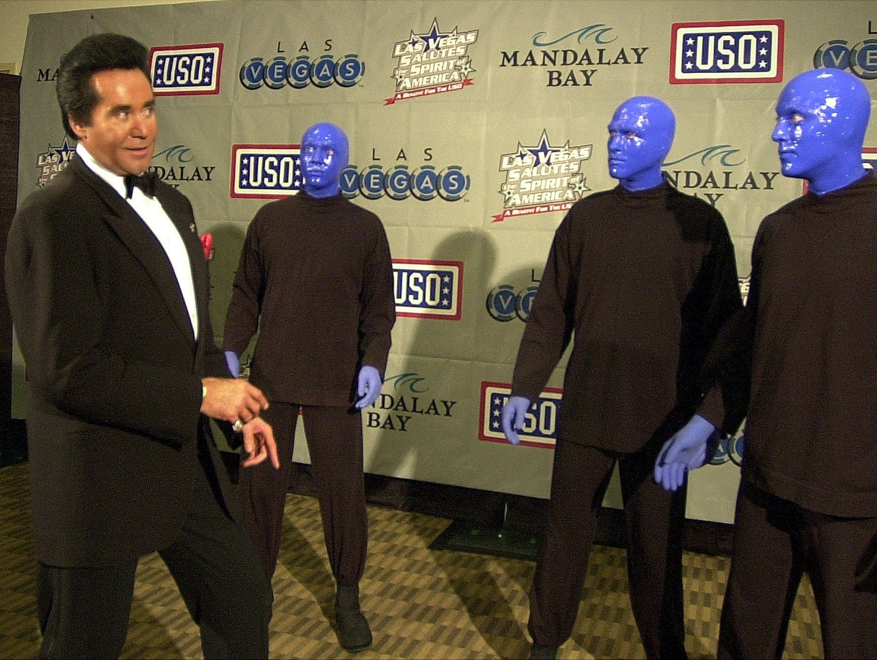 Wayne Newton jokes with members of the Blue Man Group before a USO benefit concert Sunday, Nov. 11, 2001, at the Mandalay Bay Hotel & Resort in Las Vegas.