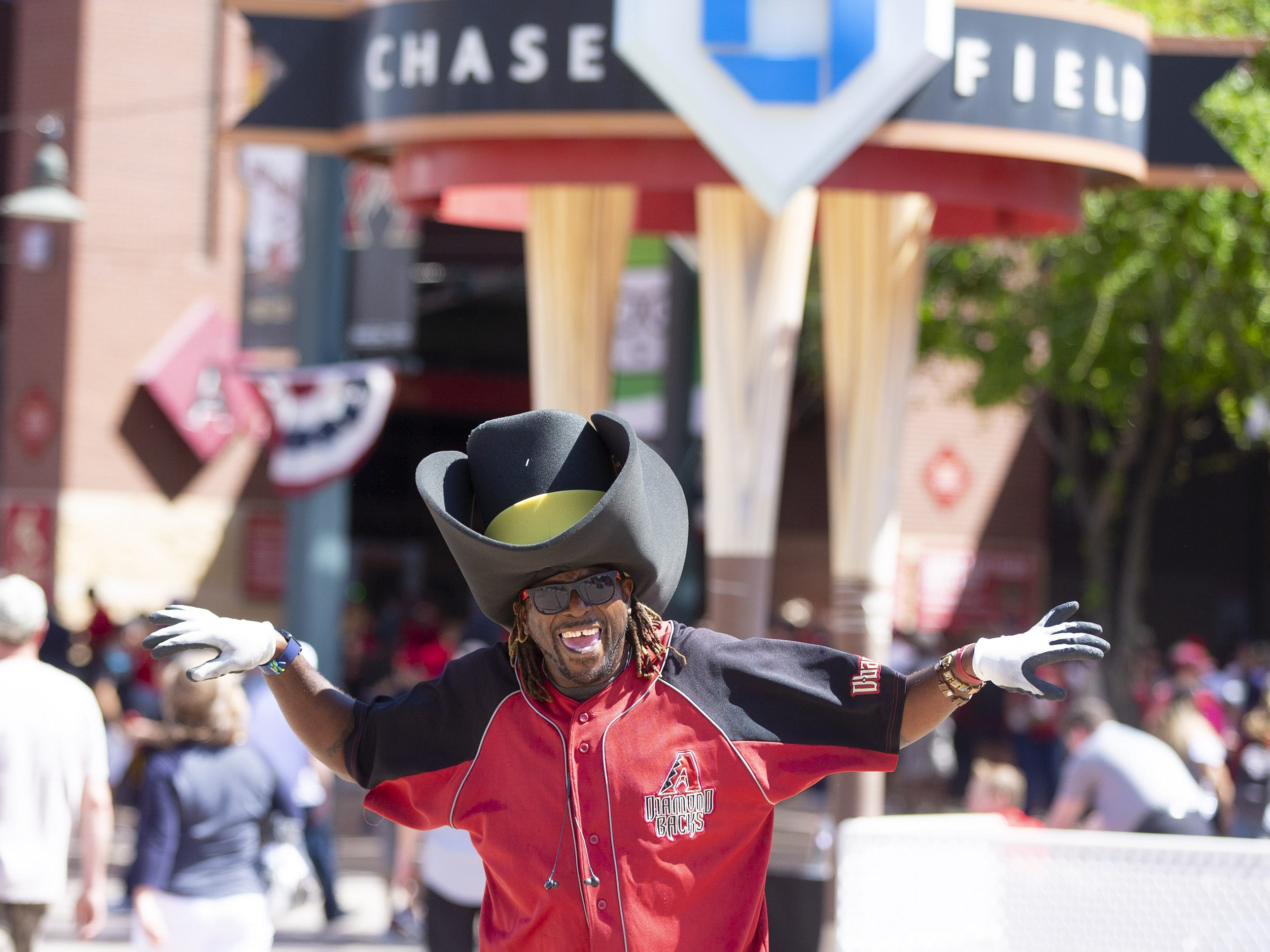 Shamon Ingram, of Phoenix,  celebrates Opening Day during a street festival at Chase Field in Phoenix on April 5.