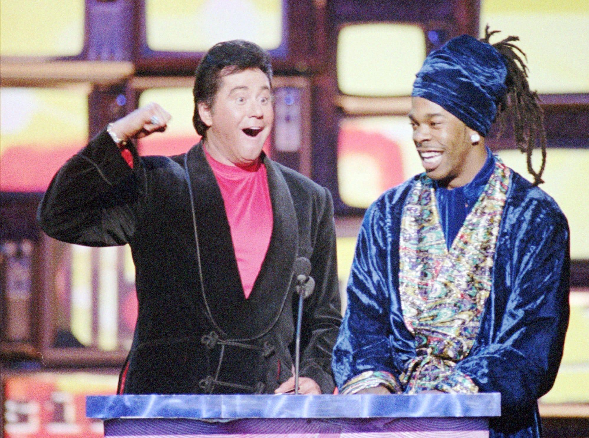 Wayne Newton (left) and Busta Rhymes appear on the Billboard Music Awards on Dec. 8, 1997.