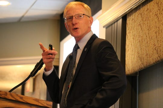 Larry Fletcher, president of Lake Erie Shores and Islands, speaks to dozens of local Lake Erie tourism business owners, public officials and other stakeholders at the 2019 State of Tourism Address at the Catawba Island Club on Thursday.