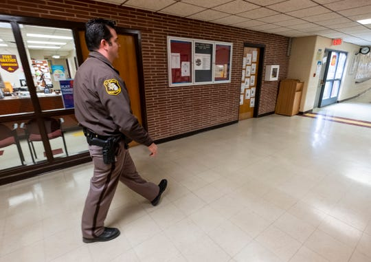 St. Clair County Sheriff Deputy Sean O'Donnell walks through the halls at Fort Gratiot Middle School Friday, April 5, 2019. O'Donnell will serve as the school resource officer between Fort Gratiot and Central middle schools based on where he is needed.