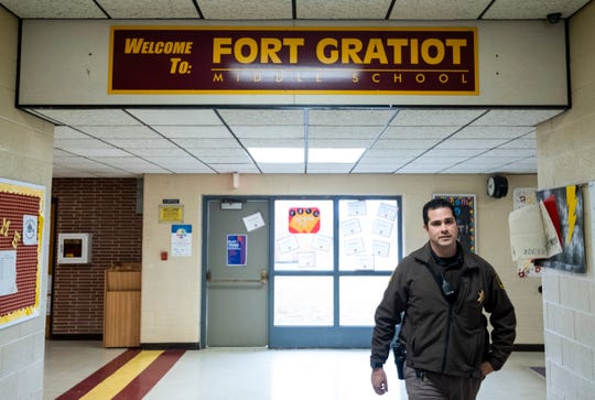 St. Clair County Sheriff's Deputy Sean O'Donnell walks through the halls at Fort Gratiot Middle School Friday, April 5, 2019. Deputy O'Donnell will serve as the school resource officer between Fort Gratiot and Central middle schools based on where he is needed.