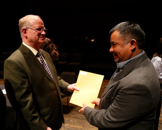 Julio A. DeLeon receives his naturalization certificate from Dutchess County clerk Brad Kendall during the Dutchess County Naturalization Ceremony inside the Sosnoff Theater at Bard College on April 5, 2019.