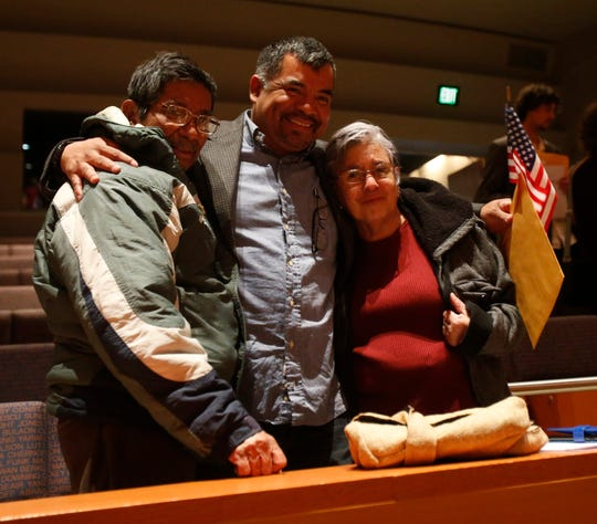 Julio A. DeLeon embraces his parents, from left Julio and Amalio following the Dutchess County Naturalization Ceremony inside the Sosnoff Theater at Bard College on April 5, 2019.