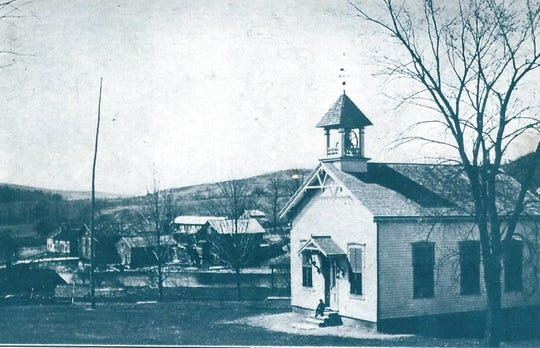 Postcard image of Bentley Memorial Schoolhouse when it operated on Mount Ross Road in the Pine Plains hamlet of Mount Ross. In 2002, the one-room structure was relocated to the Dutchess County Fairgrounds, where it is now part of the fairground's Century Museum Village. The school was in operation from 1882-1941.