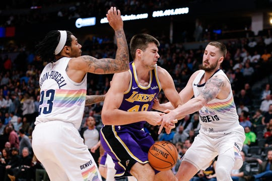 Denver Nuggets forward and Pine Plains product Tyler Lydon, right, strips Los Angeles Lakers center Ivica Zubac on Nov. 27, 2018 at the Pepsi Center in Denver.
