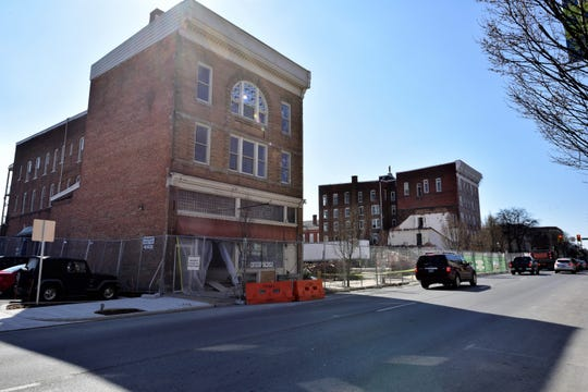 The old Wogan's Uniform Building, 56, N. Main St., Chambersburg, pictured on Wednesday, April 3, 2019. The building is to be demolished by April 14. The old Courtside Professional Building can be seen in the distance, partly demolished.  Demolition of buildings in the first block of North Main Street is part of the $67.8 million Court Facility Improvement Project.
