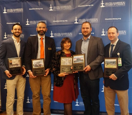 Winners of the property improvement awards at the Greater Chambersburg Chamber of Commerce awards breakfast on April 4, 2019: Ted Zimmerman, Justin Poe, Janet Pollard, Leo Schoenhofen, Jon Baker.