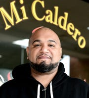 Mi Caldero owner Oziel Bones stands outside his Puerto Rican restaurant in York City Friday, April 5, 2019. His business is celebrating its tenth year of operation. Bill Kalina photo