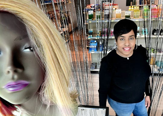 Make Me Over owner Ronda Greer poses in the window display of her shop on South Beaver Street in York City Friday, April 5, 2019. As a licensed cosmetologist, she says she feels confident advising her customers. Bill Kalina photo