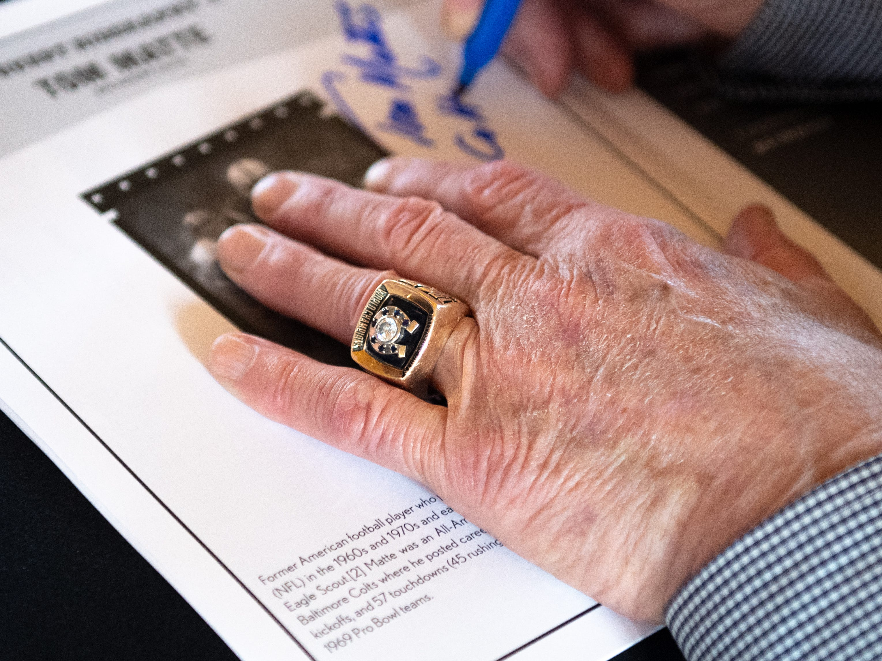 Hall of fame running back Tom Matte sports his Super Bowl ring while signing autographs during the 55th Annual York Area Sports Night, April 4, 2019 at the Heritage Hills Golf and Conference Center.