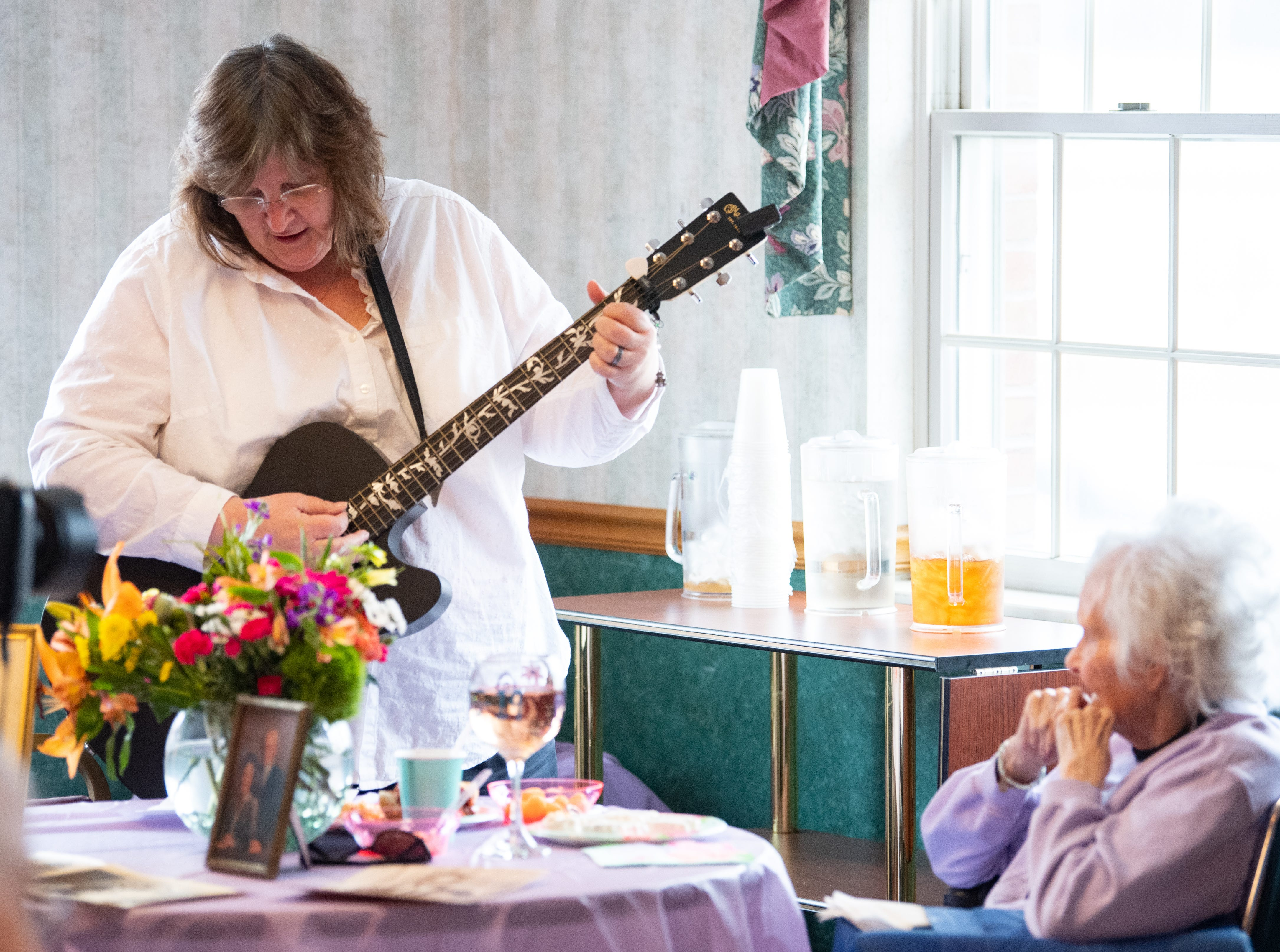 Spiritual Care Coordinator Margie Stevens performs the song that Ann Diehl and her husband danced to on their wedding day, April 5, 2019.