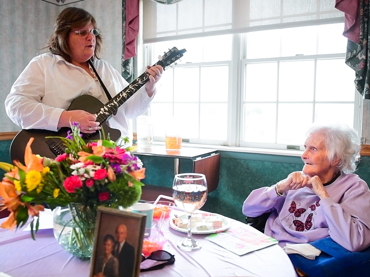 """Ann Diehl hangs on every word of Irvin Berlin's song """"Always"""" during her 73rd wedding anniversary party, April 5, 2019."""