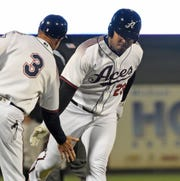 The Reno Aces' Yasmany Tomas, right, hit a home run on opening day at Greater Nevada Field on April 5, 2018.
