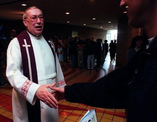 """Father Robert Bowling of Little Flower Catholic Church greets church goers after Mass Sunday on Feb. 28, 1999. Bowling is one of 12 former Reno clergy members """"credibly accused"""" of sexually abusing minors."""