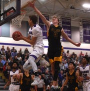 Spanish Springs' Jalen Townsell (32) drives past Galena's Moses Wood (11) during their basketball game at Spanish Springs on Feb. 16, 2018.