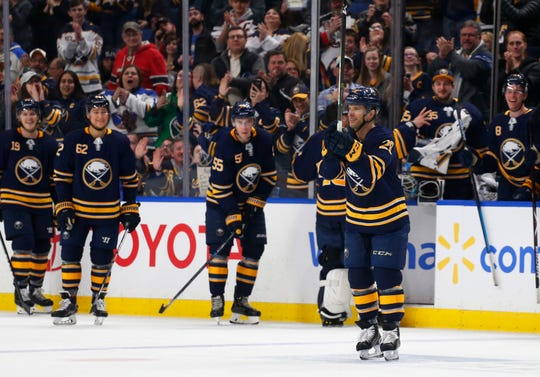 """Buffalo Sabres forward Jason Pominville (29) celebrates his goal during the third period of Thursday night's game in Buffalo. """"Nice to get that ovation for sure, I'm definitely not the type of guy who likes that attention, but the boys were signaling for me to go the middle and give a wave,'' he said."""