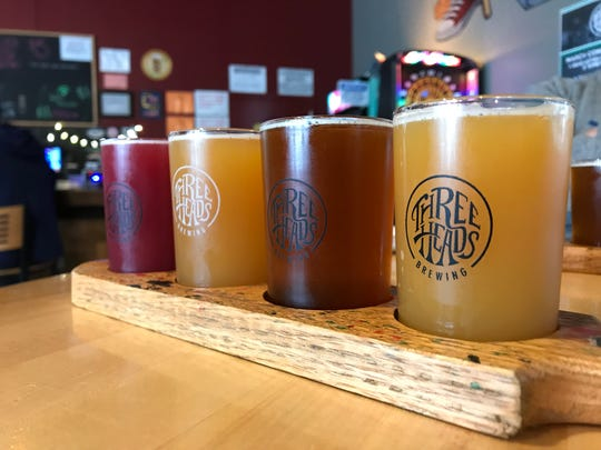 A colorful flight of new releases at Three Heads Brewing in Rochester.