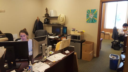 """Kerida Moates, left, works in Kevin Kiley's new office, called """"the doghouse"""" at the state Capitol in Sacramento."""
