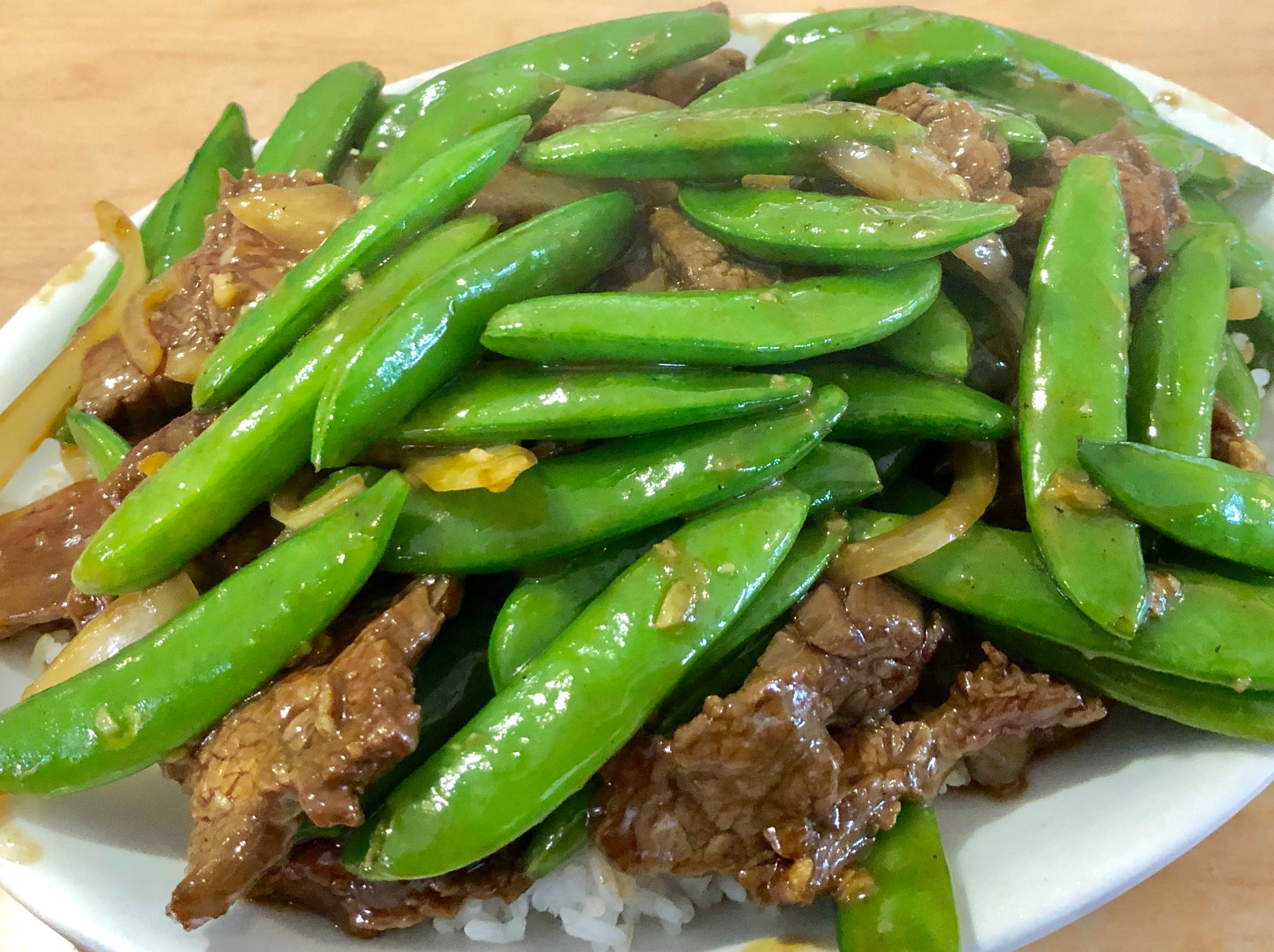 Sugar snap peas with beef over rice at Lim's.