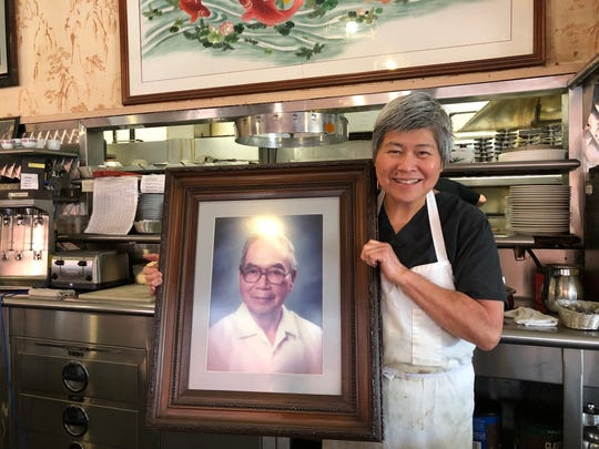 Lim's Jeannie Lim with a photo of her father, Peter Lim, who founded Lim's Cafe in downtown Redding in 1933.
