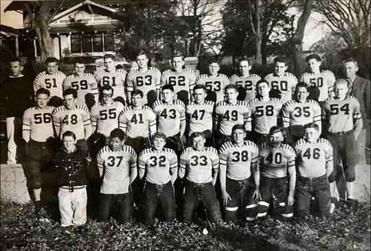 Though only five-foot-five and 120 pounds, Lade (33) ran the T-formation for his high school football team in Fairbury, Nebraska.