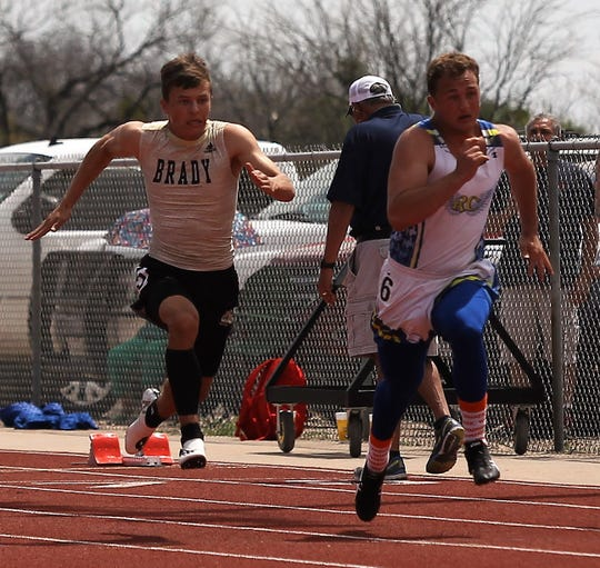 Reagan County High School's Kodee Warriner, right, and Brady's Jack Marshall race in a preliminary of the boys 100 meters at the District 4-3A Track and Field Meet Friday, April 5, 2019, in Ballinger.