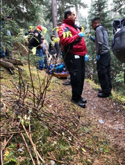 First responders rescue a couple in October 2018 at Carson National Forest in New Mexico. They were alerted by 2nd Lt. Jordan Weum to the couple pinned by a tree.
