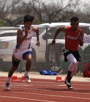 Ballinger High School's Deandre Manley, right, races against Reagan County's Pedro Sandoval during the preliminaries of the boys 100 meters at the District 4-3A Track and Field Meet Friday, April 5, 2019, in Ballinger.