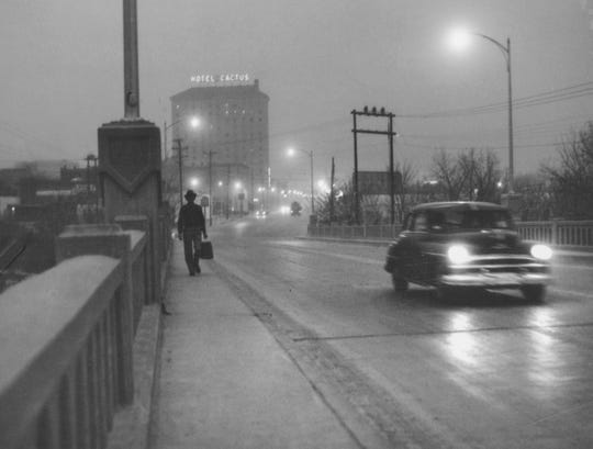 The lights of San Angelo switch-on early as a dust storm moves across the Concho Valley in this undated file photo.