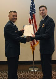 2nd Lt. Jordan Weum, 315th Training Squadron student, is presented with The Air Force Commendation Medal at his technical school graduation by Lt. Col. Mark Chang, 315th TRS commander at the Event Center on Goodfellow Air Force Base, Texas, April 4, 2019. The Air Force Commendation Medal is a military decoration which is presented to an individual who demonstrates courage.
