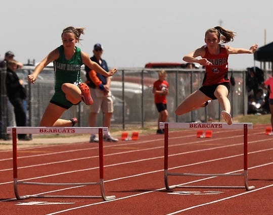 Sonora High School's Skylar Harris, right, and Wall's Autumn King race in the preliminaries of the girls 300-meter hurdles at the District 4-3A Track and Field Meet Friday, April 5, 2019, in Ballinger.