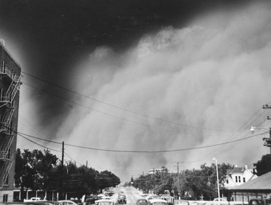 Original caption of June 9, 1955: THAR SHE BLOWS! Looking north from Shannon Hospital on Magdalen Street, this picture shows Wednesday's cloud in its rapid roll toward the downtown section. It was sapped just minutes before the blackout duster hit the main part of town and already had engulfed Lake View. Cars in the foreground soon were curbed in most instances as driving became next to impossible.