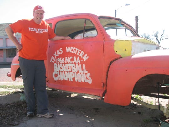 Fred Schwake with his 1946 Ford car he painted to commemorate the Texas Western College 1966 NCAA basketball championship. The car sits beside Schwake's One of a Kind Unique Antiques store in Ballinger.