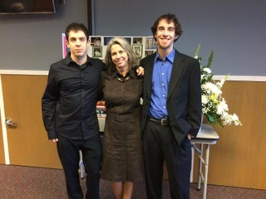 Andrew and his mother Elizabeth and his brother Jacob at a wedding.