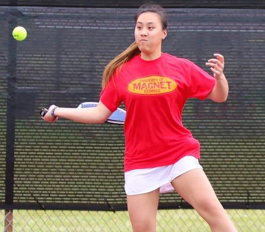 Caddo Magnet's Natalie Lim returns the ball in a recent tennis match.