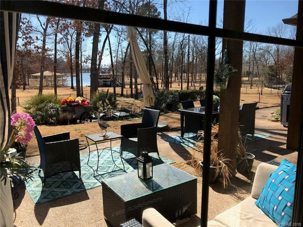 5005 Westrilee Drive, Benton  Price: $610,000  Details: 4 bedrooms, 3.5 bathrooms, 3,740 square feet  Features: Cypress lakefront home with cook's kitchen, rich woods and antique brick, hearth room with lake views, gorgeous master retreat, media room, pet washing station outdoors, 1,000 sq.ft. deck on top of the 2 stall boat house, lake lover's paradise.   Contact: Randy Bailey 210-8111