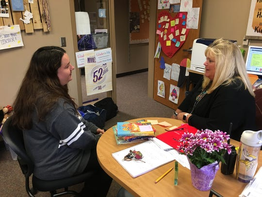 Sioux Falls mother Megan Tuve talks with Principal Kristin Skogstad about her three children Friday, April 5, 2019 at Garfield Elementary. Tuve said the support she's received from the school and its community partners has made a world of difference in her life as a single mother.