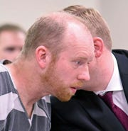 Chad Isaak listens to counsel in district court while being charged with four counts of class AA felony murder in district court on Friday, April 5, 2019, in Mandan, N.D. Isaak was arrested in Washburn on Thursday and charged with murdering four people in Mandan on Monday. He is being held on one million dollars bail.
