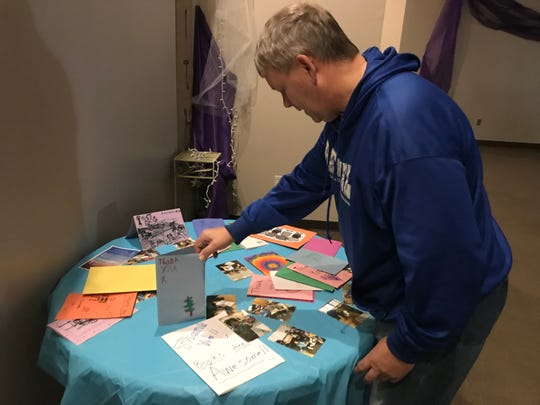 Pastor Allen Kjesbo, head of The Point is to Serve church in Sioux Falls, looks at thank you cards from Garfield Elementary students on March 29, 2019  after donations from his congregation helped at-risk students make it through the year. His church decided to partner with Garfield  after the school's parent-teacher association fizzled out a couple years ago.