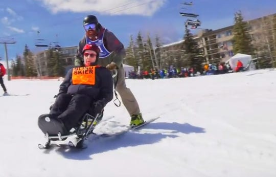 Warren Heyer, a 94-year-old legally blind World War II veteran, skis downhill at a winter clinic in Colorado April 2.