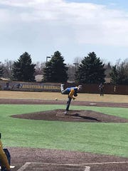 Elliot Haux throws a pitch for Baltic against Dell Rapids on March 31, 2019 at Augustana University.