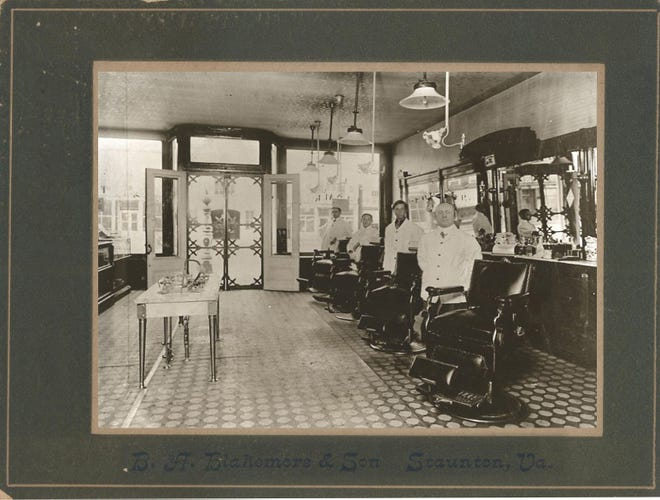Benjamin Blakemore photograph of four barbers in a shop somewhere in downtown Staunton, probably in the late 1800s or early 1900s. Was one of these unidentified barbers George Yeager?