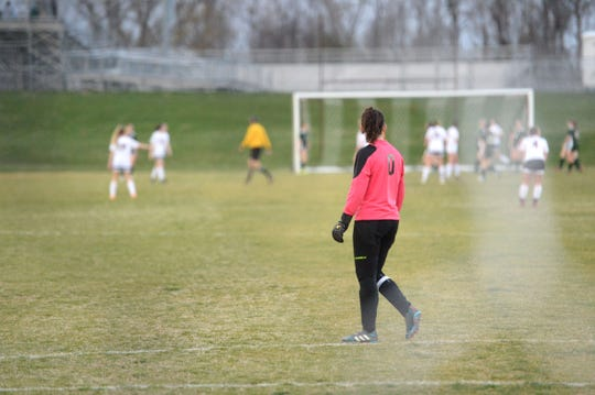 Stuarts Draft's Emma Gallaugher watches the action at the other end of the field Thursday night.