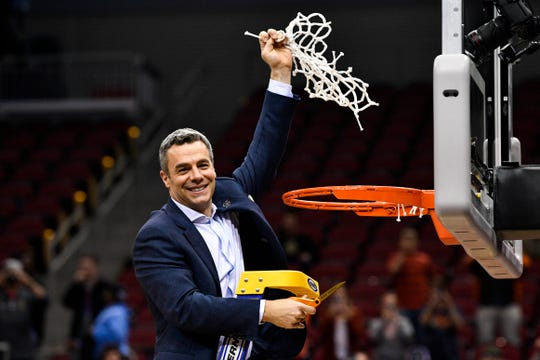 Mar 30, 2019; Louisville, KY, United States; Virginia Cavaliers head coach Tony Bennett reacts during the net cutting ceremony after the championship game of the south regional of the 2019 NCAA Tournament at KFC Yum Center.