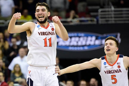 Mar 30, 2019; Louisville, KY, United States; Virginia Cavaliers guard Ty Jerome (11) celebrates with guard Kyle Guy (5) for the win over the Purdue Boilermakers in overtime in the championship game of the south regional of the 2019 NCAA Tournament at KFC Yum Center.